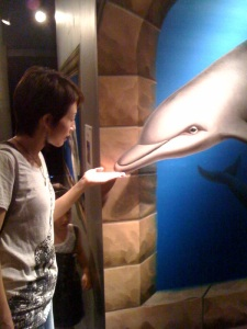Tomomi playing with dolphins